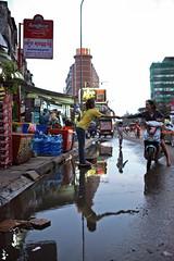 "street vendors, ground floor of ""The white building"", phnom penh (www.igorbilicphotography.com) Tags: reflection rain lowlight cambodia mood corridor shops phnompenh vendor ghetto slum buying khmerrouge paying patang kampuchea thewhitebuilding"
