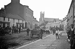 Athboy, Co. Meath (National Library of Ireland on The Commons) Tags: robertfrench williamlawrence lawrencecollection lawrencephotographicstudio thelawrencephotographcollection glassnegative nationallibraryofireland athboy ireland marketday carts horses people barefoot countymeath stjameschurch