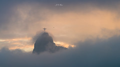 Sunset ,Christ the Redeemer (Jos Eduardo Nucci) Tags: sunset colors evening riodejaneiro olympicgames 2016 cloudscape sky christ redeemer corcovado botafogo peace blue yellow icon classic image picture joseduardonucci photography nikon d800 28300mm magical sunlight rays outdoor cidademaravilhosa rio450anos brazilian tour world flickr time life favorite beach beautiful landscape flamengo maracan sight views explore friends planet architecture statue