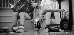 Patiently Learning (O-KLR Photographie) Tags: petitpot potty apprentissage learning patience patiently trainning book ipad tablet tablette kid enfant child reading lecture lire bw blackandwhite noiretblanc monochrome