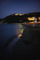 Colorful reflexes on the shore (Mario Ottaviani Photography) Tags: paesaggio landscape travel scenic view vista breathtaking tranquil tranquility serene serenity calm italy italia seascape sunset gabicce sony sonyalpha reflexes reflection nocturne night shore beach colorful colors