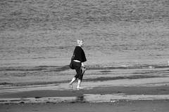 autumnal paddling 01 (byronv2) Tags: coast coastal edinburgh portobello rnbforth firthofforth river riverforth forth sea seaside scotland edimbourg blackandwhite blackwhite bw monochrome peoplewatching candid street foot feet barefeet paddling beach woman shore surf wave waves northsea