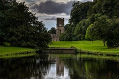 Fountains Abbey overlooking the lake (21mapple) Tags: lake fountains fountainsabbey nationaltrust hdr canon750d canon canoneos750d canoneos clouds ruins tranquil peaceful calm ripples outdoors outdoor outside trees tree grass green grey