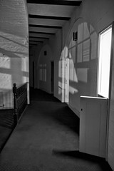 (The New Motive Power) Tags: shadow sea blackandwhite white brick abandoned lamp doors glow fort military victorian corridor arches historic spooky isleofwight solent portsmouth curve fortress derelict deserted nomansland defence canon7d