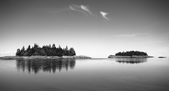 Parc du Bic 36 (gsamie) Tags: sea summer blackandwhite canada reflection nature clouds canon landscape islands quiet quebec calm saintlaurent rimouski t3i saintlawrenceriver 600d parcdubic gsamie guillaumesamie