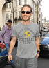 Tom Hardy leaving The Dorchester Hotel in his Audi convertible, wearing a 'Gotham City Rogues' T-shirt London, England