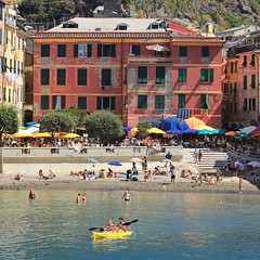 Sea Kayaking from Vernazza to Monterosso (Bn) Tags: santa travel blue sea summer cactus italy sun holiday castle art heritage beach church water colors fruit swimming painting boats harbor fishing sand topf50 colorful mediterranean kayak village hiking walk liguria tourist lovers unesco trail vineyards kayaking olives cinqueterre charming opuntia vernazza viewpoint picturesque sunbathing margherita sunbather italianriviera ruined nocars pamtree rockycoastline viadellamore 50faves dantiochia