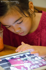 A girl who is playing with iPad (Yuripere) Tags: gettyimagesjapan12q3 gettyimagesjapan12q4