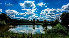 Another lake... (Jean McLane) Tags: reflects reflejos reflets lakeview lake lac lago water clouds cloudy sky blue