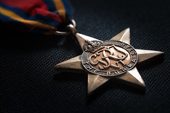 The Burma Star (roseysnapper) Tags: burmastar colorefexpro40 heliconfocus jackturton kinggeorgevi macromonday nikkor105mmf28 nikond810 royalnavy viveza20 focusstack warmedal grandfather hmm lightroom macro wwii bronze medal memories ribbon sailor star