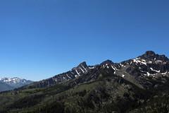 Seven Devils Peaks and other Mountains in Idaho taken from Forest Service road to Heavens Gate Vista 160701-130454 C4 (Wambeke & Wambeke Photography, Art, & Textiles) Tags: twoshotsatexactsameclocktime partialviewofsevendevilspeaks idaho idaholandscape idahomountains snowcappedmountains mountains mountainsandtrees bluesky wambekeandwambekephoto wambekewambekephotographyarttextiles charliewambekephotography canoneos80dphoto