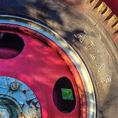 Old Wheel (tisatruett) Tags: transportation oldtime retro vintage texture planestrainsandautomobiles tire wheel metal rubber automobile firetruck macro rust old abstract color colorful shadow light geometry geometric antique antiquecar macromondays
