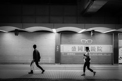 coincidence (tomorca) Tags: people man woman night shop walking light street bw monochrome
