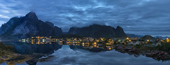Don't wake them from their blue dream ... (lunaryuna (back and playing Sisyphus in catching u) Tags: norway lofoten lofotenislands lofotenarchipelago moskenesisland reine stitchedpanorama night nighttime nightlights nightphotography nocturnalphotography le ongexposure bluehour thesmallhoursofthenight lofotenblues reinefjorden fjord lofotenwall lofotenpeaks mountainrange water reflection seeingdouble northernmirrorworlds sleepingbeauty lunaryuna