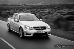 Mercedes C63 AMG Sedan: This car has enough power to stay in the same place and move the earth under it! (Leon Oosthuizen) Tags: road motion wet car rain contrast speed southafrica mercedes movement automobile fast automotive move location amg franschhoek c63 nikond700