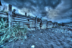 01-11 Fence Gros Morne (pixelcraftstudio) Tags: ocean sky beach clouds fence newfoundland dark sand moody erosion hdr grosmorne eastcoast wideanglelens rockyharbour