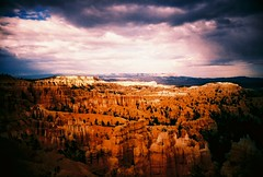 Sun Sets Over Bryce (Kelly Marciano) Tags: sunset sky orange southwest film analog toy lomo xpro crossprocessed fuji purple toycamera lofi slide roadtrip canyon slidefilm plastic velvia sw bryce brycecanyon vignette velvia100f ultrawideslim superheadz blackslimdevil