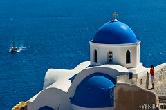 Santorini - Blue Dome Church in Oia (Yen Baet) Tags: city travel cliff church religious greek photography volcano coast town photo europe village cathedral religion scenic eu tourists santorini greece caldera ia vista coastline tradition picturesque iconic oia cyclades thira archipelago fira volcanicrock blueandwhite phira cavehouses yenbaet cycladichouses
