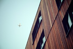 Londons Jet Set (jjohnson2012) Tags: wood sky building green london architecture modern plane aircraft airliner clearsky ecofriendly jetset commercialflight woodpanelling londonbuilding