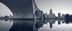 Minneapolis (Rudi1976) Tags: city bridge blue sky usa reflection water monochrome minnesota skyline architecture night skyscraper river twilight cityscape arch dusk citylife minneapolis scenics urbanscene traveldestinations famousplace locallandmark buildingexterior internationallandmark downtowndistrict tonedimage