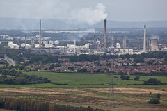 Stanlow Refinery (Gary Kinsman) Tags: road houses cloud industry grey town view cheshire northwest zoom suburban top hill nowhere overcast telephoto infrastructure oil suburbs desolate barren refinery mundane smalltown generic 2012 distant thenorth unplace placeless helsby canon70300mm chemicalindustry stanlow helsbyhill canoneos5dmarkii stanlowrefinery canon5dmkii