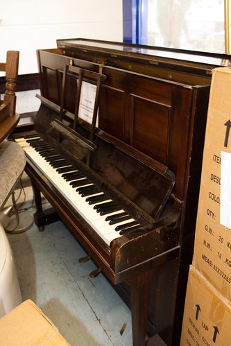 Dark wood framed piano