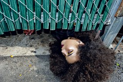 Evil is but a shadow. (Deadsketch) Tags: garbage corpse girl portrait editorial makeup yello eyeshadow afro street city gravel highlight gate green blue tint urban dead death trash dumpster 2016 new recent curls long hair matte dark morbid
