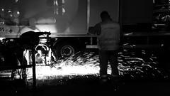 Night Workers (ANBerlin) Tags: sanding grindery railway schienen rails gleise tracks leute people arbeiter workers fliegen flying funken sparks abstrakt abstract stadt city stdtisch urban station deutschland germany berlin friedrichshain warschauerstrase frankfurtertor u5 21 m10 strasenbahn streetcar trolly cablecar tram flexity bahnsteig platform nacht night ausergewhnlich extraordinary infrastruktur infrastructure shotoniphone iphotography iphonography 6splus iphone6s iphone apple anb030 weis schwarz sw bw white black blackwhite