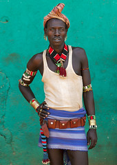 Hamer man, Turmi, Ethiopia (Eric Lafforgue) Tags: africa portrait people color vertical wall outside outdoors photography necklace beads day culture tribal bracelet bead omovalley tradition ethiopia tribe ethnic hamar perle oneperson hamer confidence traditionalculture headwear hornofafrica ethnology omo eastafrica greenbackground traditionalclothing realpeople colorimage lookingatcamera coloredbackground waistup 8031 turmi africanethnicity pastoralist snnpr oneadult southernnationsnationalitiesandpeoplesregion hamerbenaworeda ethiopianethnicity