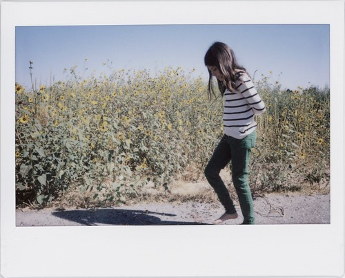 green girl skinny wide jeans sunflowers barefoot fujifilm instax