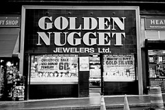 FF61:  Golden Nugget (12th St David) Tags: nyc bw newyork film window 35mm store noiretblanc manhattan financialdistrict storefront ltd olympusxa goldennugget jewelers fujiacros100 schwarzweis schwarzundweiss fzuiko35mmf28 ltdclassy