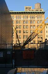 Chelsea Construction (alankin) Tags: nyc newyorkcity windows 15fav newyork buildings reflections construction chelsea cityscape manhattan fences cranes chainlink photowalk 50views watertowers redbrick dccc xfav niknala w25thstreet nikond300 nikkorafvrzoom18200mmf3556gifed 5nov2011 1600306au