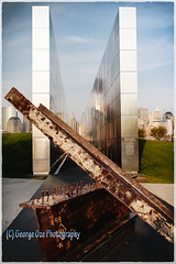 Empty Sky: New Jersey September 11th Memorial (George Oze) Tags: newyorkcity usa vertical newjersey memorial jerseycity unitedstatesofamerica worldtradecenter fineart columns exhibit manhattanskyline twintowers september11 remembrance remains steelbeams emptysky newjerseyvictims terroristattck