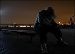 In the Air Tonight (Gareth Priest) Tags: city uk longexposure light sea portrait sky selfportrait man beach water wales night dark bench landscape still nikon mood sitting silent emotion cardiff surreal eerie spooky le thinking mysterious boardwalk cardiffbay penarth barrage bristolchannel d5100
