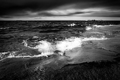 Dark sea (ulfbjolin) Tags: sea sky blackandwhite storm beach water monochrome clouds finland dark nikon waves cliffs geta land d7000 norrhavet