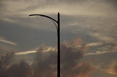 (Caitlin H. Faw) Tags: street light sunset sky usa color lamp clouds digital landscape md nikon missing maryland august baltimore 2012 parkview druidhill d90 druidhillpark gwynnfallsparkway mccullohstreet caitlinfaw caitlinfawphotography pimlicodrive