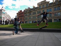 P1000471-5  Videoing a skateboarder in action. (Lawrence Holmes.) Tags: camera uk manchester lumix photographer streetphotography trainers skateboard vans 14mm gf1 candidandstreet vanstrainers