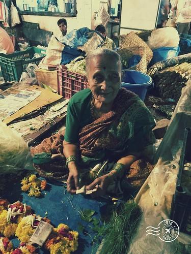 She is 100+, has been selling flowers to customers at the same place for last 30 years. #street #mumbai #india