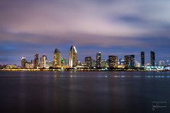 San Diego Twilight - Late Blue Hour (josefrancisco.salgado) Tags: 2470mmf28g california d5 nikkor nikon sandiego sandiegobay usa unitedstatesofamerica bay bluehour cloud clouds evening longexposure night nube nubes paisajeurbano skyline twilight crepsculo baha exposicinlarga