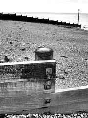 Kingsdown - Kent (jcbkk1956) Tags: worldtrekker coastal beach sea sand stones mono blackwhite nikon coolpix4300 groyne wood nuts bolts