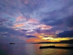 a Balinese sunset (SM Tham) Tags: asia indonesia bali island candidasa sunset dusk sky clouds sea water reflections pier ship tanker land outdoors silhouettes