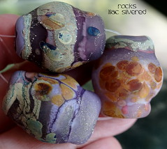 Rocks Lilac Silvered (Laura Blanck Openstudio) Tags: openstudio openstudiobeads handmade lampwork glass beads set bead big rocks nuggets pebbles stones whimsical funky odd abstract asymmetric organic earthy colorful multicolor fine arts jewelry art artisan artist made usa murano published winner show festival speckles frit raku lilac lavender purple violet grape silver silvered leaf matte glow opaque frosted etched ocher honey copper sand green