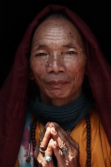 Buddhist Monk ( Jamie Mitchell) Tags: buddhist monk buddhism nepal nepalese nepali kathmandu swayambhunath swayambhu stupa face portrait portraiture pray peace religious religion sacred peaceful man wrinkles smile eyes travel asia