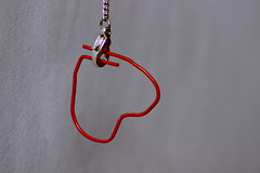 Hooked. (Nathalie_Dsire) Tags: heart freestyle fantasy macro closeup minimalistic less detail details red message symbol chain hook hooked symbolism art design sweet lovely love idea simplicity simple canoneos600d 70300 tamron70300 tamron canon eos creativity create letterclip clip  3  necklace catch wire officesupplies officesupply stationery officerequisite indoor indoors implement nice smile happy positive sign signs