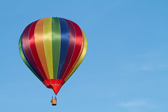 Hot Air Balloon (Mukumbura) Tags: hotairballoon balloon bright vivid rainbow technicolor red orange yellow green blue purple sky clear weather sunshine evening summer britain flight flying floating drifting lift heat travel tourism wells somerset indigo violet gettyimages