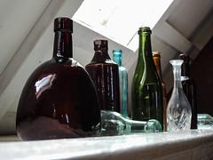 Glass Bottles (uk_dreamer) Tags: glass reflections reflection bokeh dof depthoffield stilllife bottles