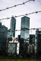 Central (camp_bell_) Tags: bank china building hong kong island central barb barbed wire fence skyscraper sky skyline grey glass