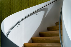 Curving (Maerten Prins) Tags: nederland netherlands nijmegen lent hotel vandervalk toekan trap wenteltrap stair stairs modern white wit light curve curves abstract composition line lines hall indoor shadow black railing wall green tiles