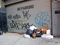 No Parking, New York, NY (Robby Virus) Tags: newyorkcity newyork nyc ny bigapple manhattan city no parking garbage graffiti sign tags metal door garage sidewalk