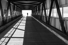 The light at the end of the tunnel / Going alone, going strong (zgr Grgey) Tags: 2016 35mm bw baumwall d750 hamburg nikon samyang architecture depth perspective shadow silhouette germany